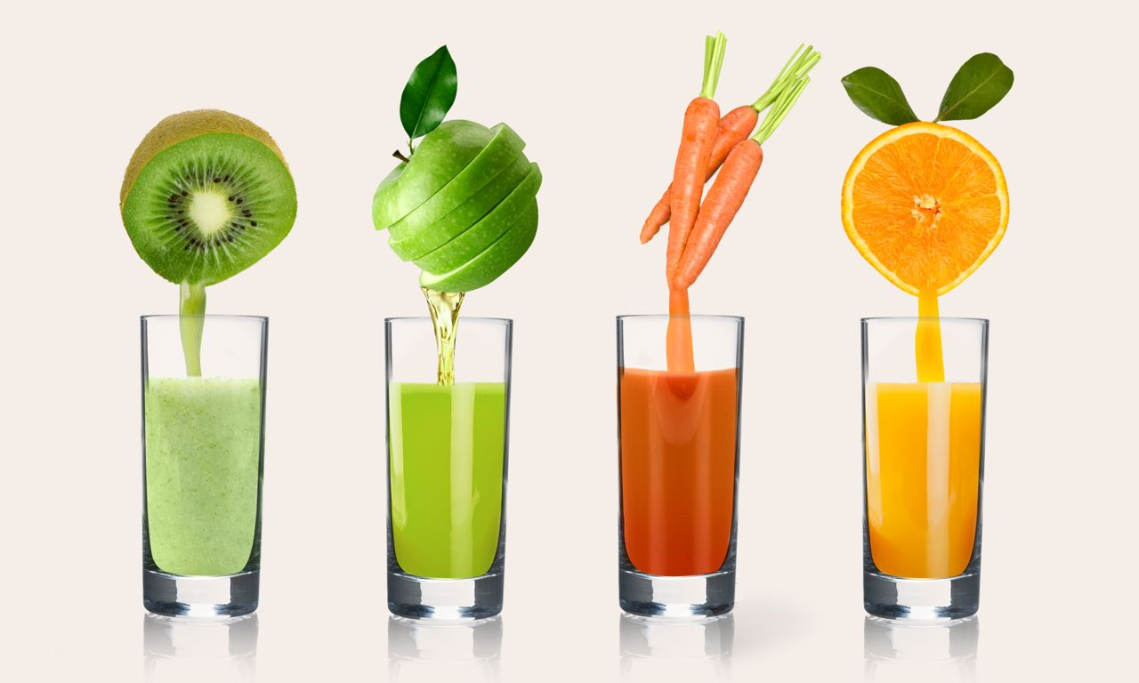 StockUnlimited_fruit juice_glasses_natural_apple_carrot_orange_kiwi